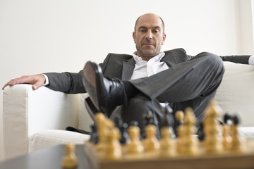 Businessman looking at chess board