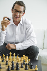 Mid adult holding chess piece, portrait