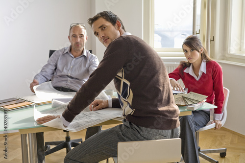 Business people sitting in office, portrait