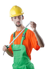 Worker with measuring tape on white