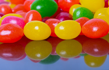 Jelly beans reflected in glossy black