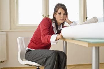 Businesswoman contemplating in office, portrait