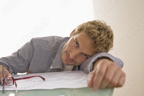 Mid adult man leaning on table, portrait