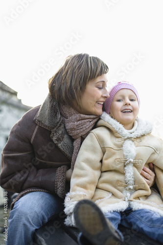 Mother with daughter smiling, portrait
