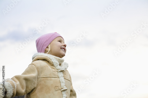 Girl smiling, low angle view