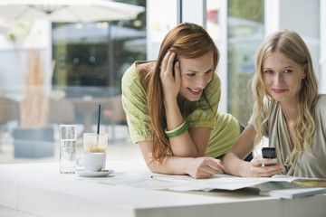 Young women at cafe, smiling