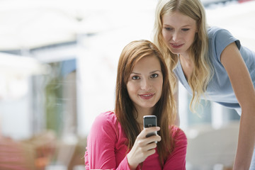 Young women looking at mobile phone