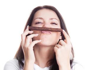 woman smelling a cigar