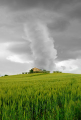 tornado surrounds the house on the hill