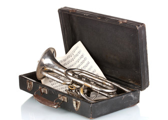 old trumpet and notebook with notes in case isolated on white