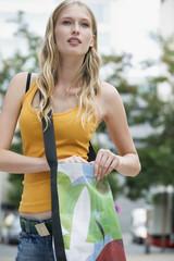 Young woman with shoulder bag, portrait