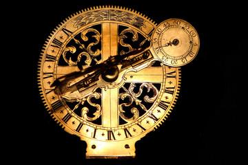 veyr old golden sundial beneath