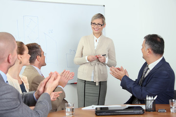 Business team applauding at presentation