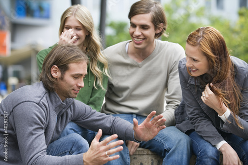 Young couples sitting together, smiling