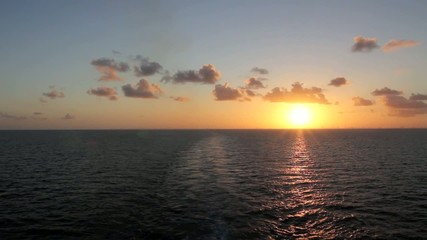 View Across Calm Ocean Towards the Sunset
