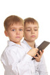 Two reading boys with electronic book