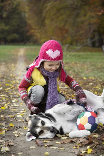 Girl with dog in garden