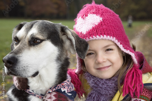 Girl with dog in garden, portrait