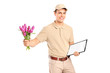 Delivery boy holding a clipboard and bunch of flowers