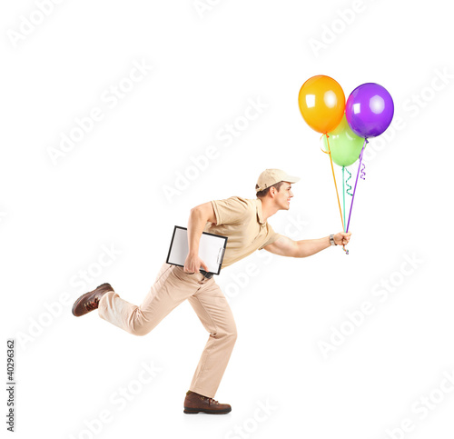 Delivery boy in a rush delivering balloons
