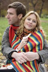 Young man hugging young woman