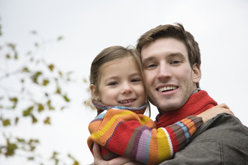 Father with daughter, smiling, close-up