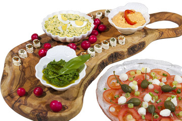 Delicius organic food on olive tree plate, tasty herbs spreads