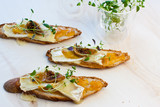 crostini with chutney and brie garnished with a fig