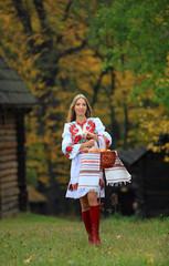 Portrait of beautiful young woman in Ukrainian costume