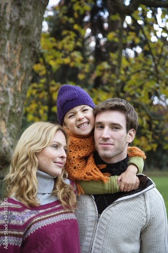 Daughter with parents, smiling