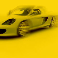 Yellow car in motion