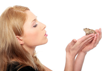 A gorgeous young blond woman kissing a frog