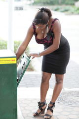 Woman grabbing a news paper