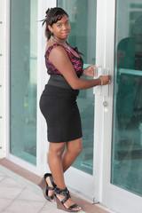 Woman posing by the door