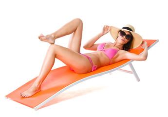 Cute woman on orange sunbed