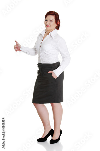 Young businesswoman gesturing ok.