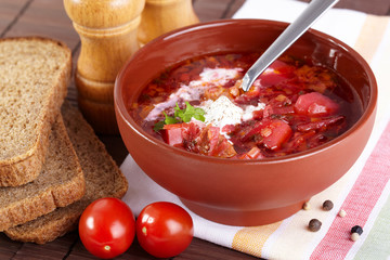Russian cuisine. Borscht on the served table