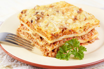 Italian cuisine. Meat lasagna on plate