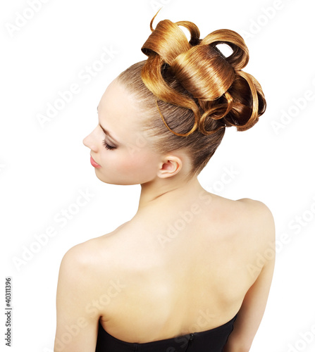 Girl with creative hairstyle isolated on white background