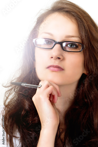 Beautiful brunette model in reading glasses