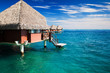 Over water bungalow with steps into clear ocean