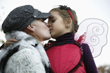 Mother kissing daughter, close-up