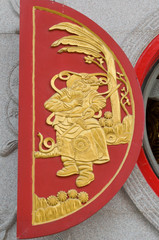Native chinese sculpture on wooden window in temple