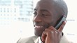 Black businessman smiling on the phone