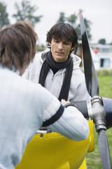 Young men repairing airplane