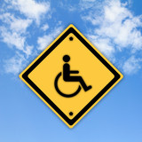Handicap disabled sign on beautiful sky background.