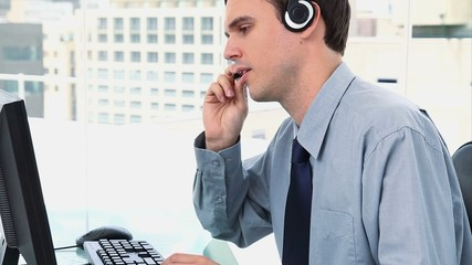 Businessman working with a computer and a headset
