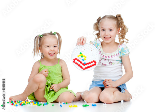 cute girls sisters playing together over white background