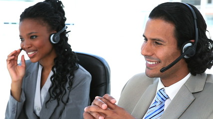 Smiling people speaking with headset