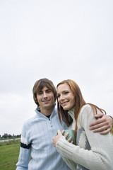 Young couple smiling, portrait